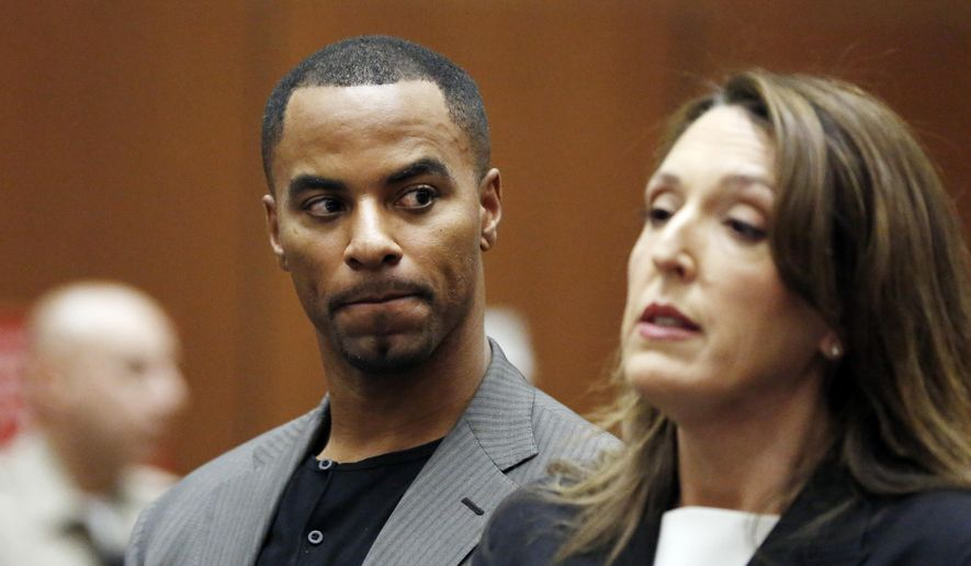 FILE - In this Feb. 20, 2014, file photo, former NFL All-Pro safety Darren Sharper looks toward his attorney, Blair Berk, during an appearance in Los Angeles Superior Court in Los Angeles. A Los Angeles Superior Court judge set the new preliminary hearing date for Sharper, on charges that he drugged and raped two women he met at a West Hollywood nightclub. The date has been tentatively set for Feb. 17.  (AP Photo/Mario Anzuoni, Pool, File)