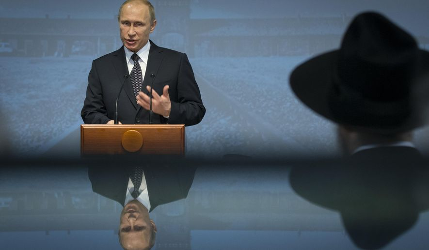 Russian President Vladimir Putin speaks at Moscow's Jewish Museum and Tolerance Center at a ceremony to mark the 70th anniversary of the liberation of the Auschwitz Nazi death camp in 1945 by Soviet troops, Tuesday, Jan. 27, 2015. (AP Photo/Alexander Zemlianichenko, pool)