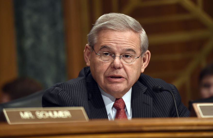 Senate Banking Committee member Sen. Robert Menendez, D-N.J. gives his opening statement on Capitol Hill in Washington, Tuesday, Jan. 27, 2015, during the committee's hearing on Iran sanctions. A group of Senate Democrats told the White House on Tuesday that they won't support passage of an Iran sanctions bill until at least the end of March. (AP Photo/Susan Walsh)