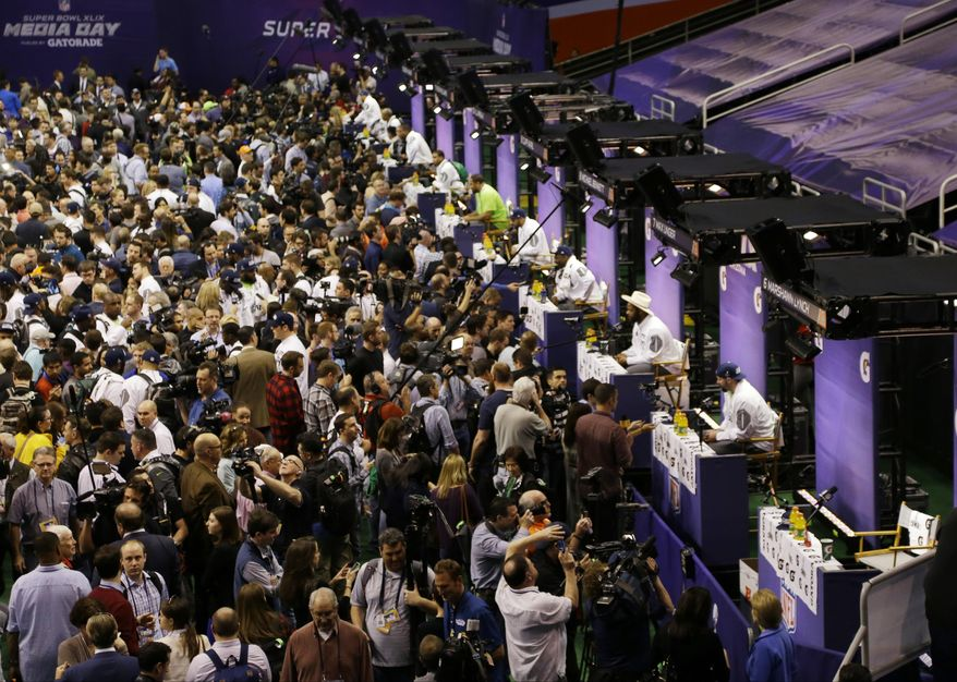 Seattle Seahawks' Marshawn Lynch's seat, far right, remains empty after he left during media day for NFL Super Bowl XLIX football game Tuesday, Jan. 27, 2015, in Phoenix. (AP Photo/Charlie Riedel)