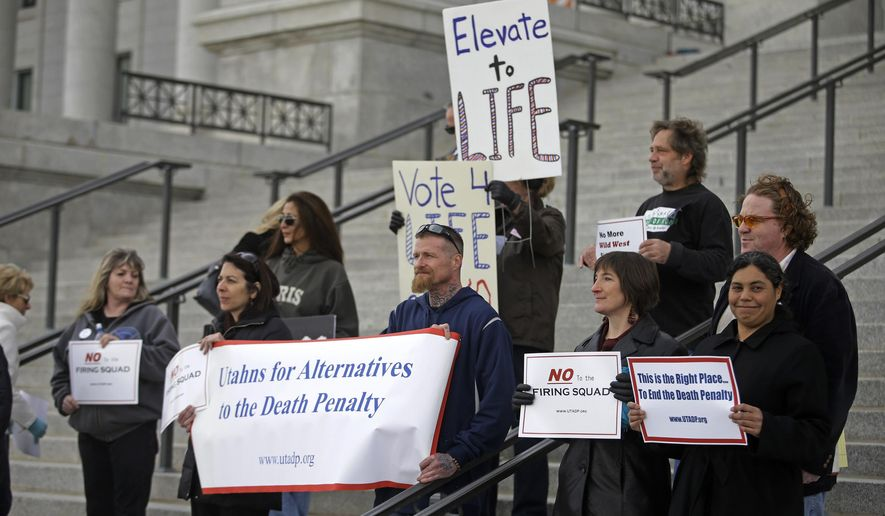 A group opposed to capital punishment plans over one lawmaker's plan to resurrect the use of firing squads protests outside the Utah State Capitol Tuesday, Jan. 27, 2015, in Salt Lake City. The group Utahns for Alternatives to the Death Penalty argues firing squad executions are a gruesome relic of the state's Wild West past that create a media frenzy around condemned inmates. (AP Photo/Rick Bowmer)