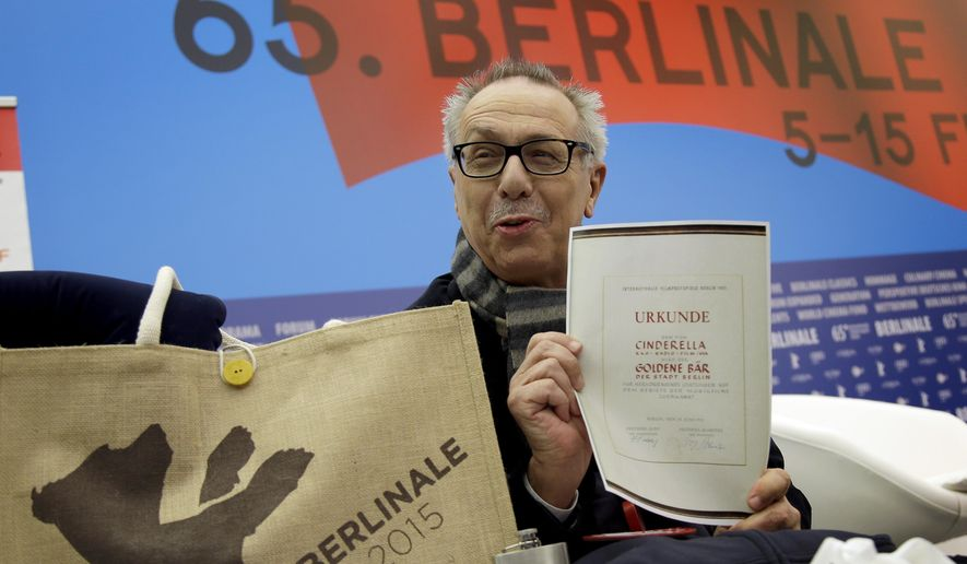 Dieter Kosslick director of the International Film Festival Berlin, the Berlinale, holds a copy of a 65 years old Golden Bear award certificate as he poses for the media prior to the annual program press conference in Berlin, Germany, Tuesday, Jan. 27, 2015. The 65. Berlinale will take place in the German capital from Thursday, Feb. 5, until Sunday, Feb. 15, 2015.(AP Photo/Michael Sohn)