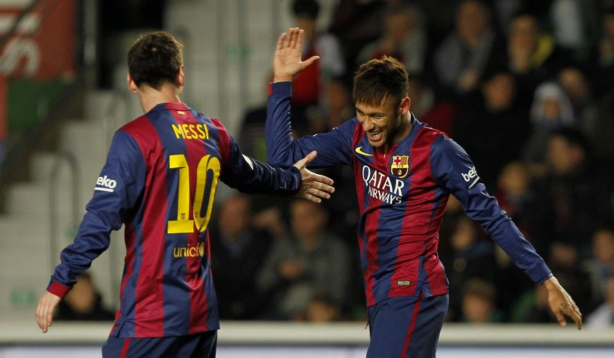 Barcelona's Neymar, from Brazil, right, is congratulated by teammate Lionel Messi, from Argentina, left, after he scored during a Spanish La Liga soccer match between Elche and Barcelona, at the Martinez Valero stadium in Elche, Spain, Saturday, Jan. 24, 2015. (AP Photo/Fernando Bustamante)