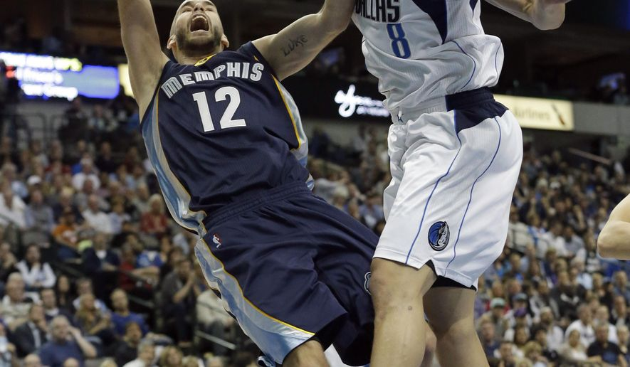 Memphis Grizzlies guard Nick Calathes (12) shoots against Dallas Mavericks forward Dwight Powell (8) during the first half of an NBA basketball game Tuesday, Jan. 27, 2015, in Dallas. (AP Photo/LM Otero)