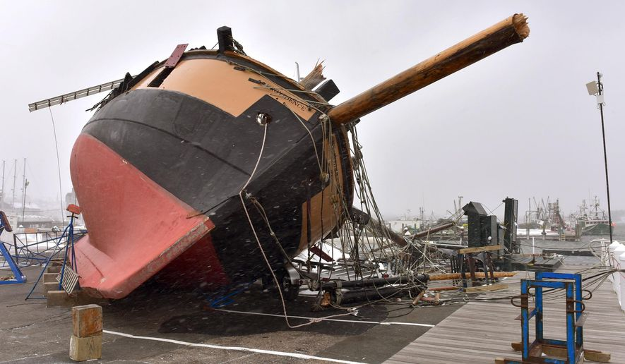Rhode Island's tall ship, a replica of the USS Providence, rests on its side on the dock at at the Newport Shipyard after strong wind gusts topped it during the snowstorm Tuesday, Jan. 27, 2015, in Newport, R.I. Owner and captain Thorpe Leeson said the ship, stored there for the winter, sustained extensive damage. (AP Photo/Newport Daily News, Dave Hansen)