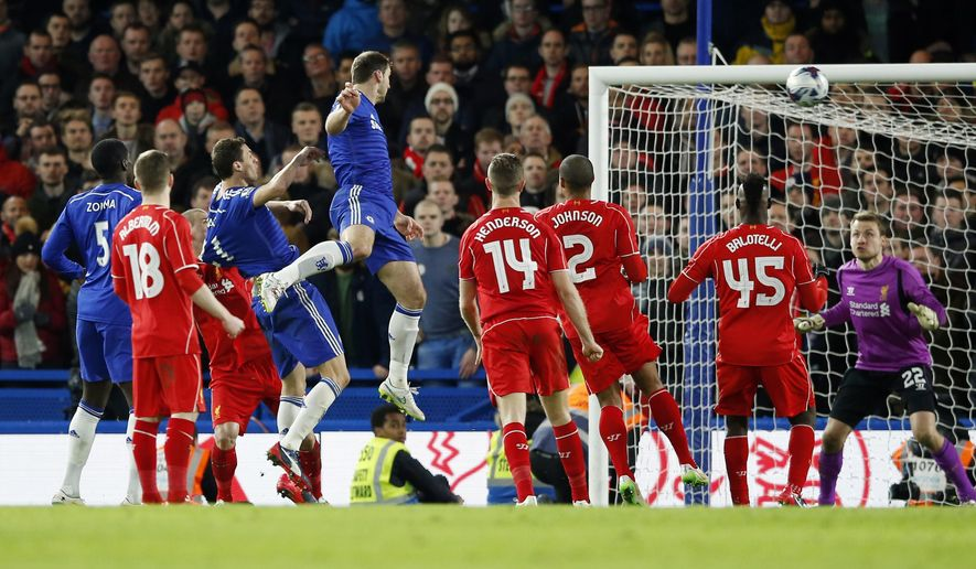 Chelsea's Branislav Ivanovic, top, heads the ball and scores during the English League Cup semifinal second leg soccer match between Chelsea and Liverpool at Stamford Bridge stadium in London, Tuesday, Jan. 27, 2015. (AP Photo/Alastair Grant)