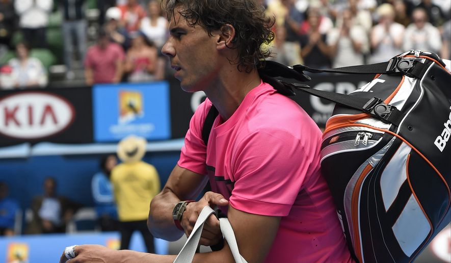 Rafael Nadal of Spain leaves the Rod Laver Arena after his quarterfinal loss to Tomas Berdych of the Czech Republic in their quarterfinal match at the Australian Open tennis championship in Melbourne, Australia, Tuesday, Jan. 27, 2015. (AP Photo/Andy Brownbill)