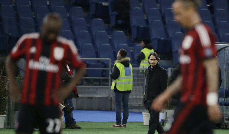AC Milan coach Filippo Inzaghi looks at his players during a Serie A soccer match between Lazio and AC Milan in Rome's Olympic stadium, Saturday, Jan. 24, 2015. (AP Photo/Gregorio Borgia)