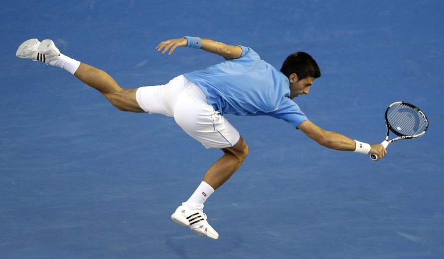 Novak Djokovic of Serbia stretches out for a return to Milos Raonic of Canada during their quarterfinal match at the Australian Open tennis championship in Melbourne, Australia, Wednesday, Jan. 28, 2015. (AP Photo/Lee Jin-man)