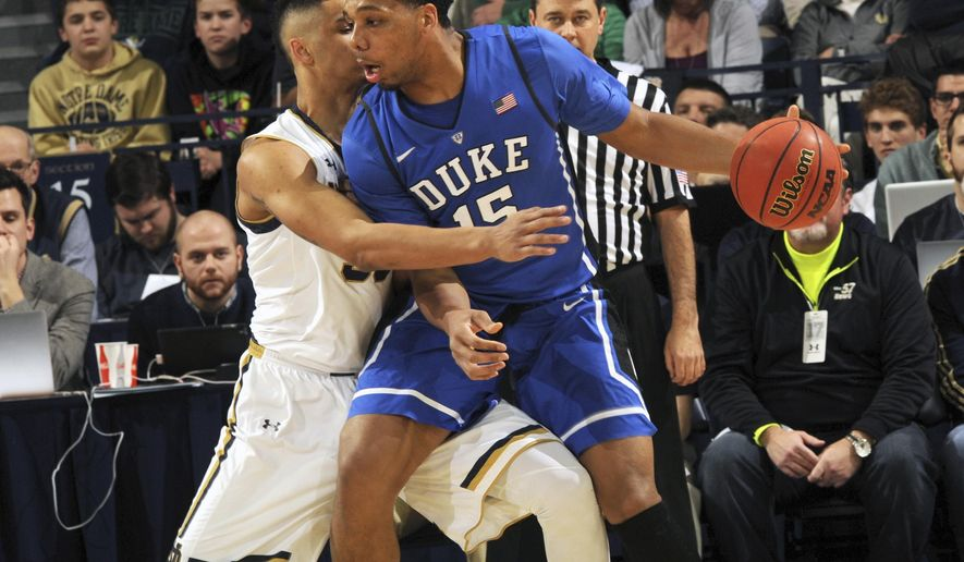 Duke center Jahil Okafor, right, drives the lane as Notre Dame forward Zach Auguste defends in the first half of an NCAA college basketball game Wednesday, Jan. 28, 2015, in South Bend, Ind. (AP Photo/Joe Raymond)