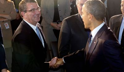 President Barack Obama shakes hands with Deputy Secretary of Defense Ash Carter after he spoke at the Nunn-Lugar Cooperative Threat Reduction (CTR) symposium being held at the National Defense University at Fort McNair in Washington, Monday, Dec. 3, 2012.(AP Photo/Charles Dharapak)