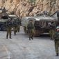 "Israeli soldiers secure the Israel-Lebanon border, Wednesday. Hezbollah claims the attack destroyed a number of Israeli vehicles and caused casualties among ""enemy ranks."" Israel later fired at least 35 artillery shells into Lebanon. (Associated Press)"