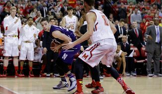 Maryland's Jake Layman helps out defensively on a double-team against Northwestern on Sunday. The senior leaders want the Terrapins want to get back to a defense-first mentality, (Associated Press)
