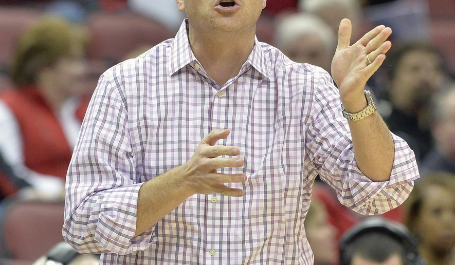 FILE - In this Sunday, Jan. 25, 2015, file photo, Louisville head coach Jeff Walz gives instructions to his team during the second half of an NCAA college basketball game against Miami  in Louisville, Ky. He enters Thursday night's ACC game against No. 23 Syracuse with a chance for his 200th career coaching win with the No. 8 Cardinals. By (AP Photo/Timothy D. Easley, File)