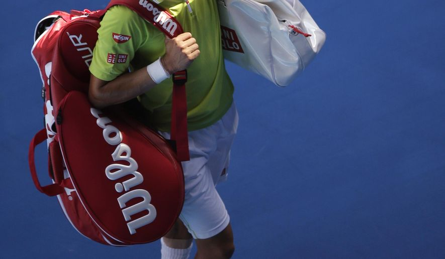 Kei Nishikori of Japan leaves Rod Laver Arena after his quarterfinal loss to Stan Wawrinka of Switzerland at the Australian Open tennis championship in Melbourne, Australia, Wednesday, Jan. 28, 2015. (AP Photo/Lee Jin-man)