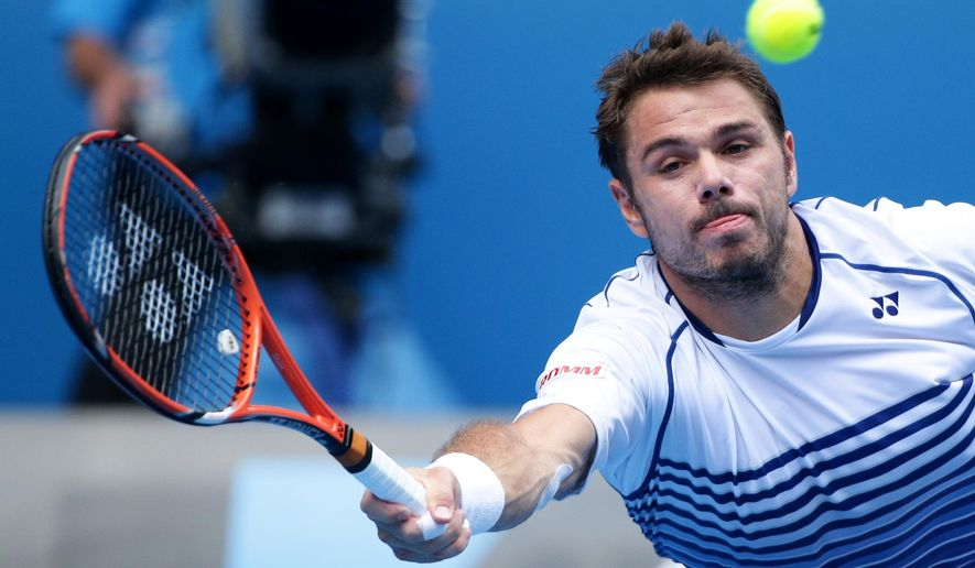 Stan Wawrinka of Switzerland makes a forehand return to Kei Nishikori of Japan  during their quarterfinal match at the Australian Open tennis championship in Melbourne, Australia, Wednesday, Jan. 28, 2015. (AP Photo/Rob Griffith)