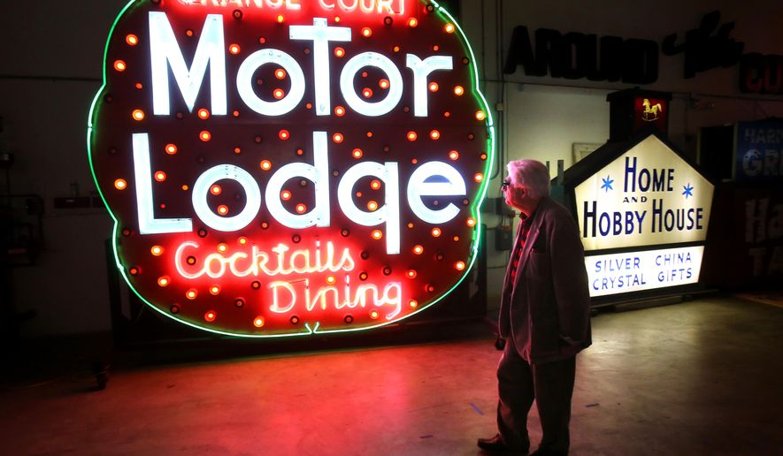ADVANCE FOR THE WEEKEND OF JAN 31-FEB. 1 AND THEREAFTER - In a Thursday, Jan. 15, 2015 photo, Dr. Larry Ruggiero, director of the Charles Hosmer Morse Museum of American Art, walks past the restored Orange Court Motor Lodge sign, in the museum's private warehouse in Winter Park, Fla.   (AP Photo/Orlando Sentinel, Joe Burbank)