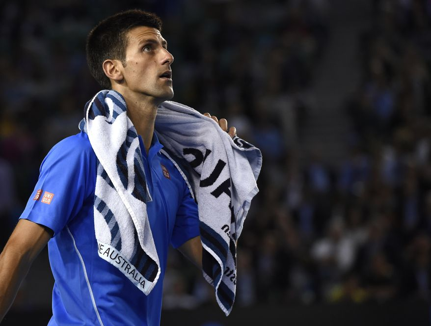 Novak Djokovic of Serbia walks on the court as he plays Milos Raonic of Canada during their quarterfinal match at the Australian Open tennis championship in Melbourne, Australia, Wednesday, Jan. 28, 2015. (AP Photo/Andy Brownbill)