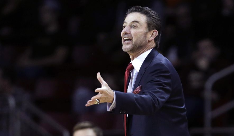 Louisville head coach Rick Pitino calls to his players during the first half of an NCAA college basketball game against Boston College in Boston, Wednesday Jan. 28, 2015. (AP Photo/Charles Krupa)