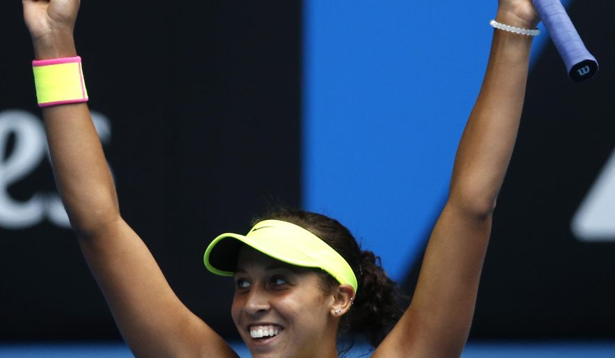 Madison Keys of the U.S.  waves after defeating her compatriot Venus Williams in their quarterfinal match at the Australian Open tennis championship in Melbourne, Australia, Wednesday, Jan. 28, 2015. (AP Photo/Vincent Thian)