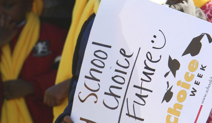 Eric Rose, 6, from Ellwood Christian Academy, in Selma, participates in a National School Choice Week rally at the Alabama State Capitol, Wednesday Jan. 28, 2015, in Montgomery, Ala. Parents and students rallied on the lawn of the Alabama Capitol Wednesday, urging state politicians to provide more publicly funded education options.(AP Photo/Hal Yeager)
