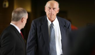 """Former Navy SEAL and Minnesota Gov. Jesse Ventura (right) walks into Warren E. Burger Federal Building during the first day of jury selection in a defamation lawsuit in St. Paul, Minn., on July 8, 2015. Ventura, who won $1.8 million in the lawsuit against the estate of the late Chris Kyle, says he won't see the """"American Sniper"""" film partly because Kyle is no hero to him. (Associated Press/The Star Tribune, Elizabeth Flores) **FILE**"""