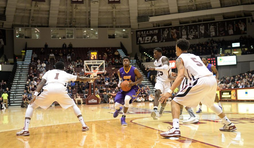 Northern Iowa's Wes Washpun goes up against Southern Illinois Jalen Pendleton (1), Deion Lavender (5) and Anthony Beane (25) during the first period of a Missouri Valley Conference game at the SIU Arena in Carbondale, Ill., Wednesday, Jan. 28, 2015. (AP Photo/Stephen Lance Dennee)