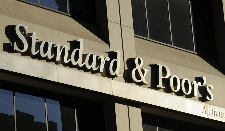 FILE - This Oct. 9, 2011, file photo shows Standard & Poor's rating agency in New York. Standard & Poor's is close to a $1.37 billion settlement with the Obama administration and U.S. states over allegations it knowingly inflated its ratings of risky mortgage investments that helped trigger the financial crisis. (AP Photo/Henny Ray Abrams, File)