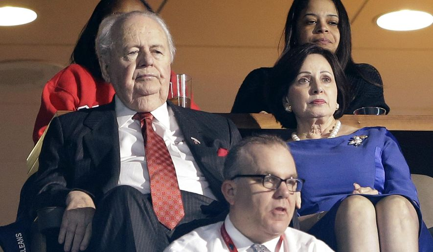 New Orleans Pelicans and New Orleans Saints owner Tom Benson, left, watches from his suite with his wife, Gayle Benson, during the first half of the Pelicans' NBA basketball game against the Denver Nuggets in New Orleans, Wednesday, Jan. 28, 2015. (AP Photo/Gerald Herbert)