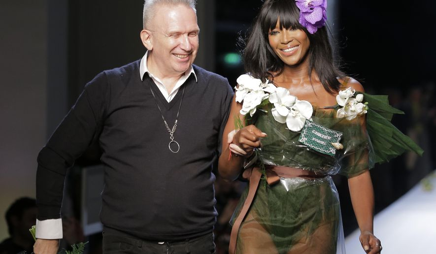 French designer Jean Paul Gaultier and model Naomi Campbell are applauded at the end of his Spring-Summer 2015 Haute Couture fashion collection, presented in Paris, France, Wednesday Jan 28, 2015. (AP Photo/Jacques Brinon)