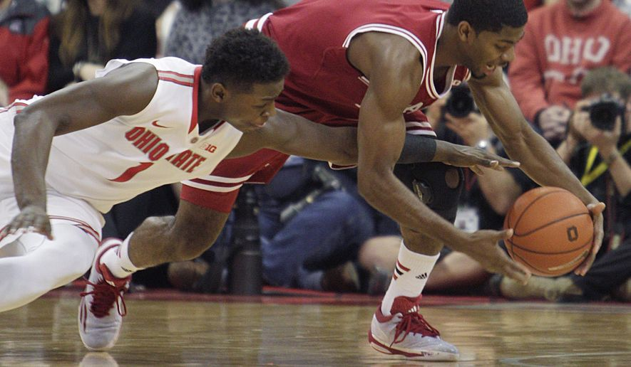 Indiana's Robert Johnson, right, and Ohio State's Jae'Sean Tate fight for a loose ball during the second half of an NCAA college basketball game, Sunday, Jan. 25, 2015, in Columbus, Ohio. Ohio State beat Indiana 82-70. (AP Photo/Jay LaPrete)