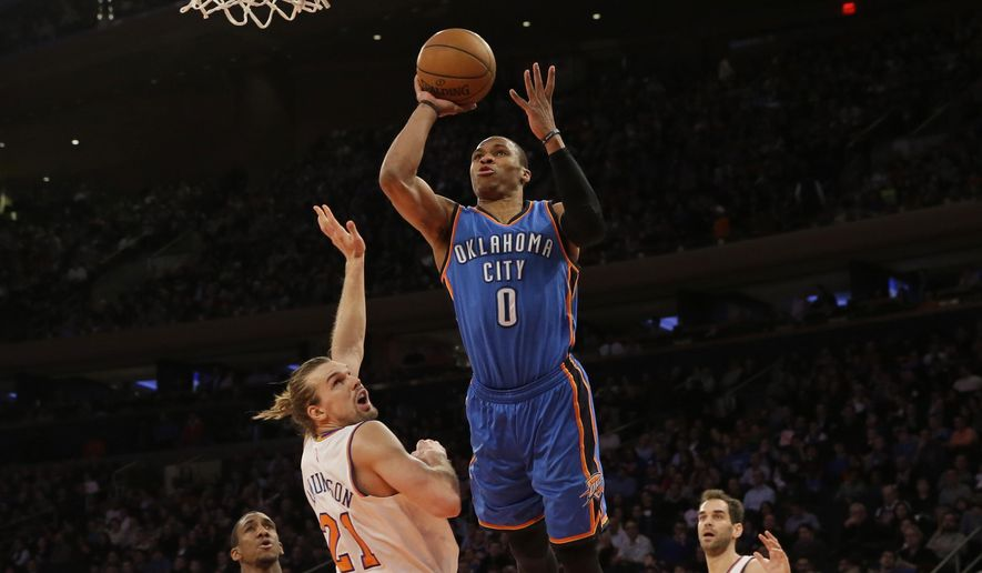 Oklahoma City Thunder guard Russell Westbrook (0) goes up past New York Knicks forward Lou Amundson (21) during the first half of NBA basketball game, Wednesday, Jan. 28, 2015 at Madison Square Garden in New York.  (AP Photo/Mary Altaffer)