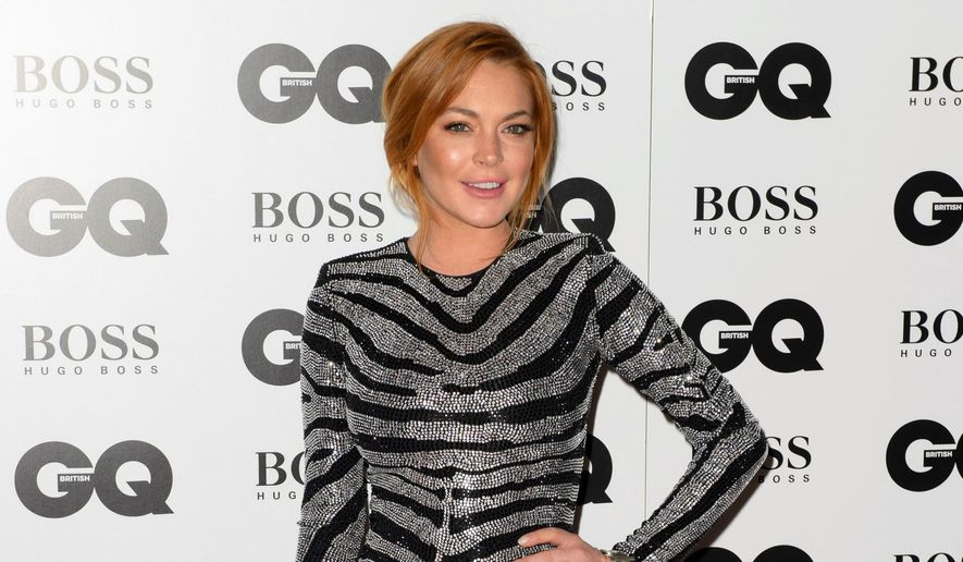 Lindsay Lohan arrives for the GQ Men Of The Year Awards 2014 in central London, in this Sept. 2, 2012, file photo. (Photo by Jonathan Short/Invision/AP, File)