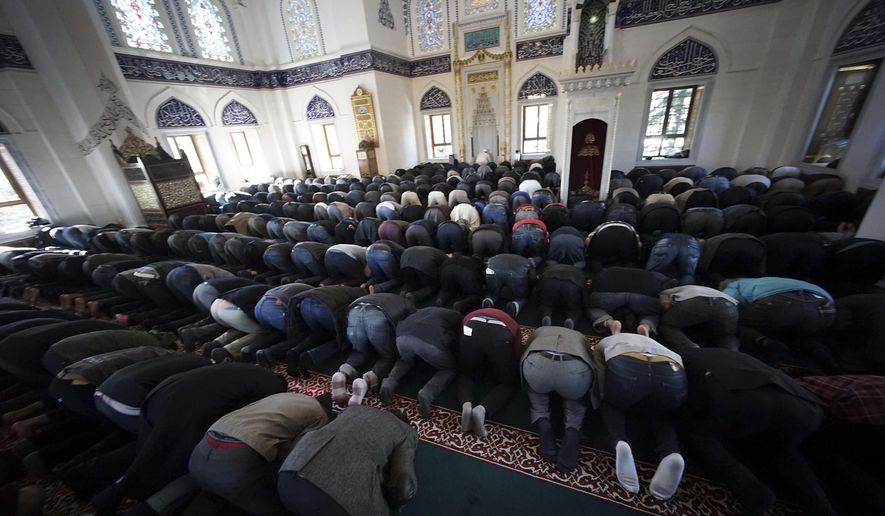 In this Friday, Jan. 23, 2015, photo, Muslims residing in Japan offer Friday prayers at Tokyo Camii, the largest mosque in Japan, in Tokyo. (AP Photo/Eugene Hoshiko)