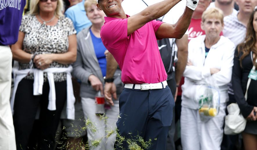 Tiger Woods hits out of the rough on the 10th hole during the first round of the Phoenix Open golf tournament, Thursday, Jan. 29, 2015, in Scottsdale, Ariz. (AP Photo/Rick Scuteri)