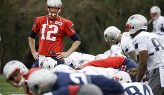 New England Patriots quarterback Tom Brady (12) warms up during practice Thursday, Jan. 29, 2015, in Tempe, Ariz. The Patriots play the Seattle Seahawks in NFL football Super Bowl XLIX Sunday, Feb. 1. (AP Photo/Mark Humphrey)