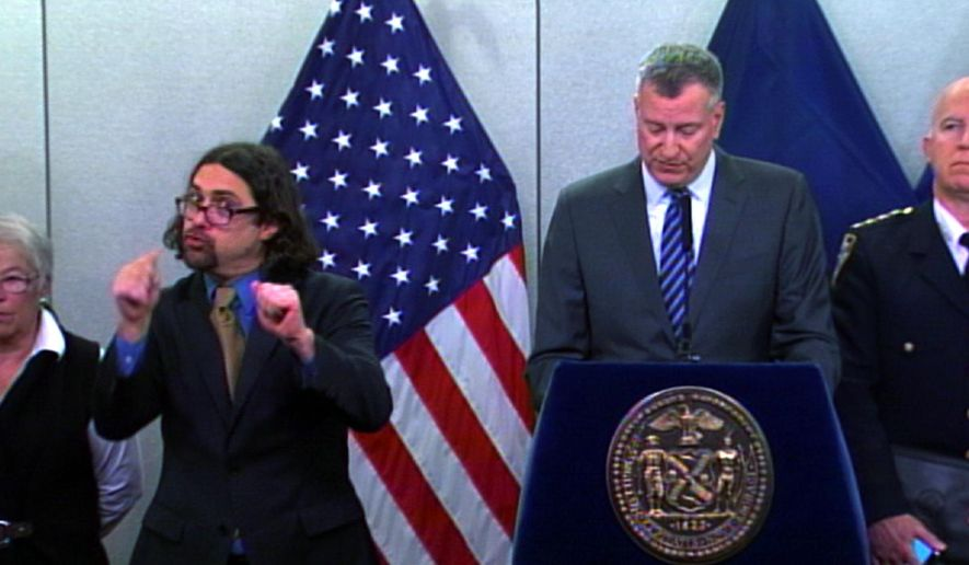 In this Monday Jan. 26, 2015 video frame grab released by New York City Office of The Mayor, Sign-language Interpreter Jonathan Lamberton, left, translates during a news conference by New York City Mayor Bill de Blasio (AP Photo/ New York City Office of The Mayor)