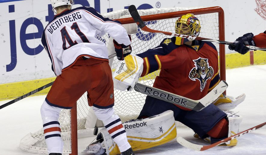 Columbus Blue Jackets center Alexander Wennberg (41) scores against Florida Panthers goalie Roberto Luongo (1) in the second period of an NHL hockey game in Sunrise, Fla., Thursday, Jan. 29, 2015. (AP Photo/Alan Diaz)
