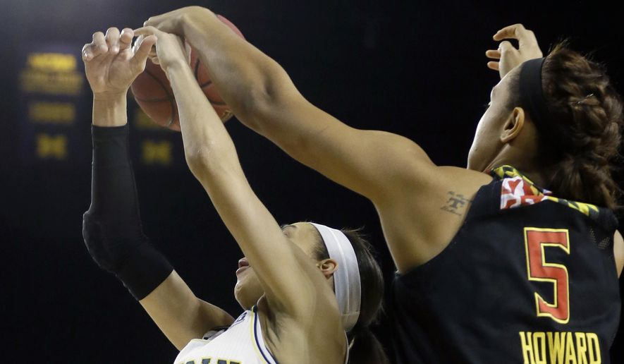Maryland center Malina Howard (5) knocks the ball away from Michigan guard Shannon Smith (5) during the first half of an NCAA college basketball game, Thursday, Jan. 29, 2015 in Ann Arbor, Mich. (AP Photo/Carlos Osorio)