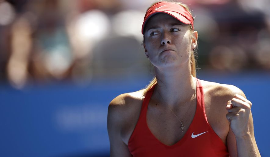 Maria Sharapova of Russia celebrates a point won against her compatriot Ekaterina Makarova during their semifinal match at the Australian Open tennis championship in Melbourne, Australia, Thursday, Jan. 29, 2015. (AP Photo/Bernat Armangue)
