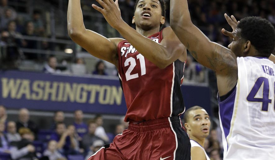 Stanford's Anthony Brown (21) shoots as Washington's Shawn Kemp Jr. defends during the second half of an NCAA college basketball game Wednesday, Jan. 28, 2015, in Seattle. (AP Photo/Elaine Thompson)