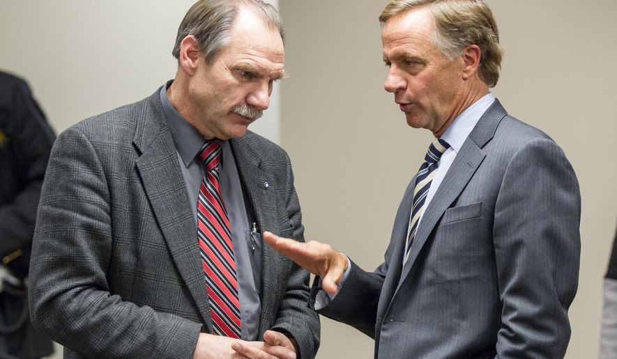Gov. Bill Haslam confers with state Rep. Mark Pody, R-Lebanon, after a Thursday, Jan. 29, 2015, meeting with lawmakers in Murfreesboro, Tenn., to discuss his proposal to extend health coverage to more than 280,000 low-income Tennesseans. (AP Photo/Erik Schelzig)
