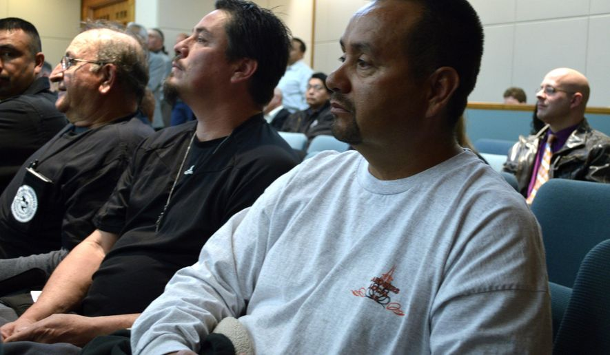 Alfredo Armijo, 49, of Penasco, N.M., a member of Laborer Union 16, listens Thursday, Jan. 29, 2015, in Santa Fe at a New Mexico House Business and Employment Committee considering a contentious right-to-work bill. With a new Republican majority in the lower chamber for the first time in decades, supporters and opponents lined up to debate the proposal. Republican Gov. Susana Martinez has voiced support, saying in her State of the State address workers should have the choice whether they want to join a union or contribute to one. (AP Photo/Russell Contreras)