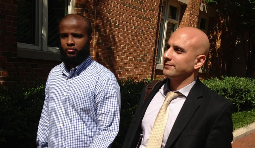 Gulet Mohamed, left, leaves the federal court in Alexandria, Va., with his attorney, Gadeir Abbas, with the Council on American-Islamic Relations, after a hearing challenging his placement on the government's no fly list, Aug. 16, 2013. The FBI on Jan. 29, 2015, added Liban Haji Mohamed, a former taxi driver from northern Virginia to its list of most wanted terrorists, saying he was a recruiter for the al-Shabab terror group in Somalia. (Associated Press) ** FILE **