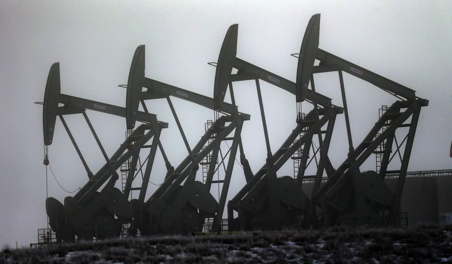 In this photo taken Dec. 19, 2014, oil pump jacks work in unison, in Williston, N.D. Never mind dropping oil prices. U.S. producers are pushing harder than ever for the right to sell U.S. crude oil overseas. It might seem counterintuitive: Oil prices are as low as they have been at any point since 2009 and the height of the Great Recession. Depending on the projection, prices could drop further still with slowing economies across the world. Oil producers are playing a longer game, betting that long-term demand remains strong and new markets offer lucrative rewards for U.S. producers.  (AP Photo/Eric Gay)