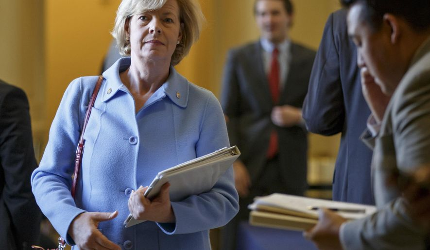 FILE - In this Nov. 18, 2014 file photo, Wisconsin Democratic Sen. Tammy Baldwin leaves a strategy session on Capitol Hill in Washington. Baldwin says she is accepting responsibility for not calling for an investigation sooner amid allegations that a Tomah VA medical center overprescribed opiates. (AP Photo/J. Scott Applewhite, File)