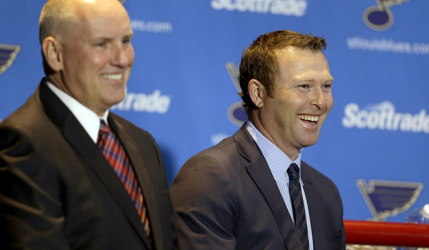 St. Louis Blues' Martin Brodeur, right, smiles along side Blues general manager Doug Armstrong during a news conference to announce Brodeur's retirement from NHL hockey, Thursday, Jan. 29, 2015, in St. Louis. Brodeur finished his career with St. Louis after 21 seasons as goaltender with New Jersey. He will remain with the Blues as a senior adviser to general manager Doug Armstrong. (AP Photo/Jeff Roberson)