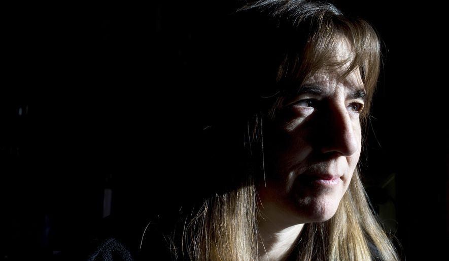 Dianna Gruno, mother 27-year-old son Ken Gruno, who disappeared a month ago, looks out of the window at her home as she seeks answers and any clues to his whereabouts on Wednesday, Jan. 28, 2015, in Millington Township, Mich. Ken Gruno was last seen at an Otisville Hotel Bar heading west. (AP Photo/The Flint Journal-MLive.com, Jake May) LOCAL TELEVISION OUT; LOCAL INTERNET OUT