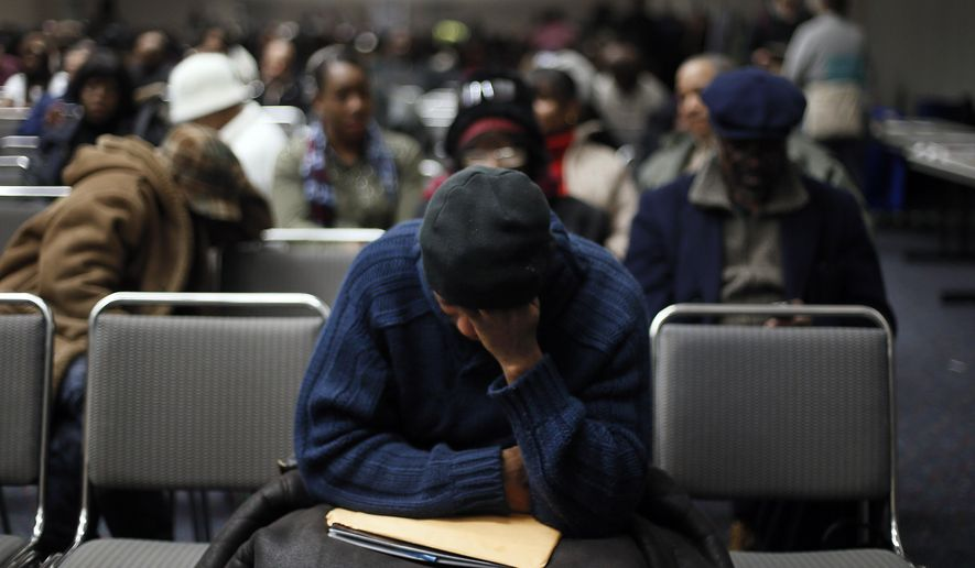 Homeowners sit in a conference room in Detroit's Cobo Center while waiting for their cases to be heard to avoid foreclosure from tax debts in Detroit Thursday, Jan. 29, 2015. Hundreds of Detroit homeowners at risk of losing their property are flocking to hearings that offer them a last-ditch chance to avoid foreclosure. (AP Photo/Paul Sancya)
