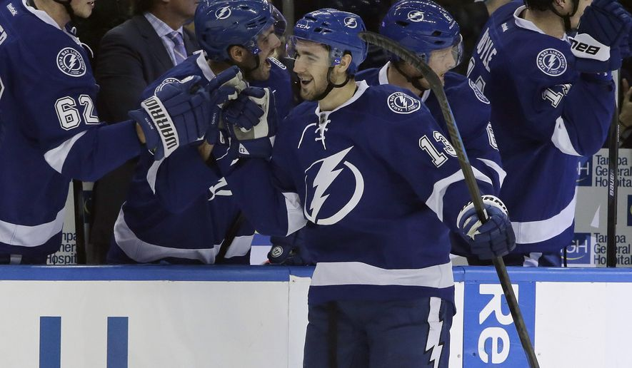 Tampa Bay Lightning center Cedric Paquette (13) celebrates with the bench after his second goal against the Detroit Red Wings during the first period of an NHL hockey game Thursday, Jan. 29, 2015, in Tampa, Fla. (AP Photo/Chris O'Meara)